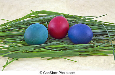 Three easter eggs on grass - Closeup of three easter eggs on...