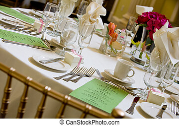 wedding table with green menu