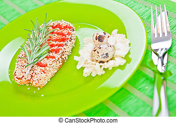 fish with sesame on a green plate
