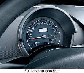 tachometer - Modern car illuminated dashboard closeup,...