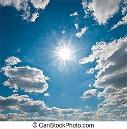 Sun rays in a blue sky