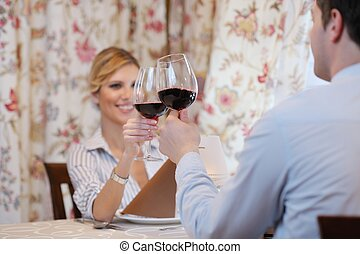 young couple having dinner at a restaurant - A young couple...