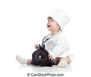 Adorable girl with clothes of doctor and rabbit over white