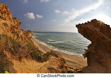 Freakish rocks on coast of Mediterranean sea shined by the...
