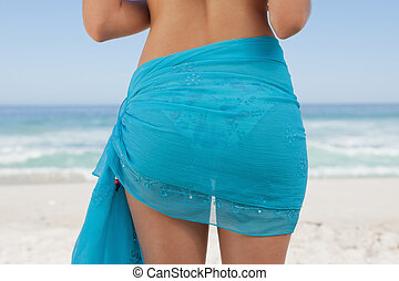 Rear view of a young woman wearing a sarong