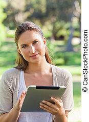 Woman with a tablet computer in the countryside - Young...