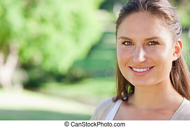 Smiling woman spending her day in the park