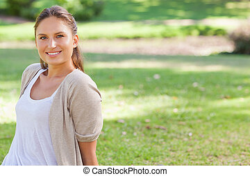 Smiling woman enjoying her time in the park