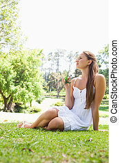 Woman sitting on the grass in a park
