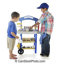 Young Candy Entrepreneur - A young preschooler making a...