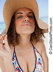 Young attractive woman standing upright with puckered lips