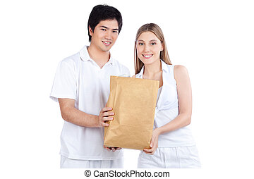 Young Couple  Holding Paper Bag