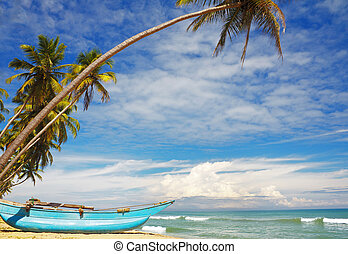 Sri-Lanka sunny coast with fishers boat