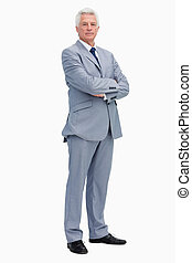 Portrait of a serious man in a suit against white...