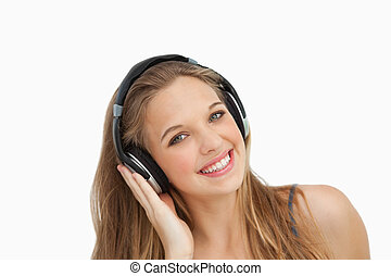 Close-up of a beautiful student wearing headphones