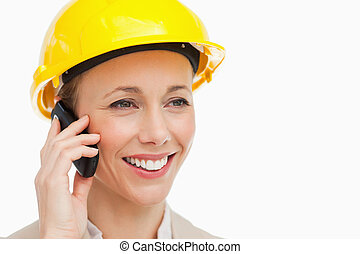 Woman wearing safety helmet on the phone