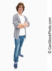 Smiling male student posing in jeans