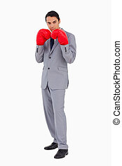 Man in a suit wearing boxing gloves