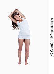 Smiling woman stretching herself