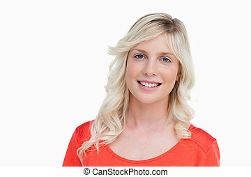 Young blonde woman showing a great smile while looking at the camera