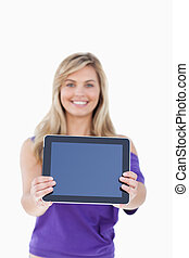 Tablet computer being held by a blonde woman