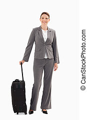 Businesswoman with suitcase - A businesswoman with a...