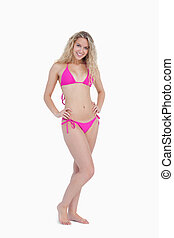 Attractive young blonde woman wearing a swimsuit
