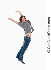 Happy male student posing by jumping