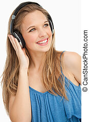 Close-up of a beautiful young woman wearing headphones