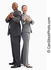 Smiling business people with thumbs up - Smiling business...
