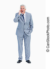 Portrait of a businessman shouting against white background