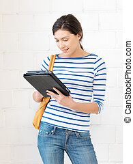 happy teenage girl with tablet pc computer - picture of...