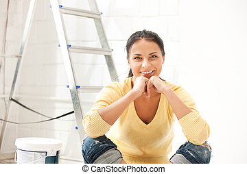 lovely housewife making repairing works - bright picture of...