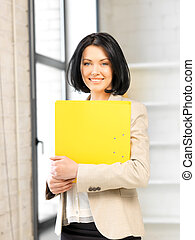 woman with folder - bright picture of beautiful woman with...