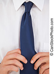 Man making a tie knot - Close-up of a man making a tie knot...