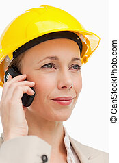 Woman on the phone wearing safety helmet