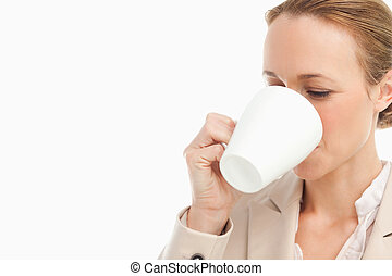 Woman in a suit drinking a coffee