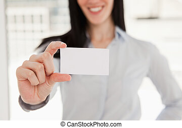Close up of a business card being held by a woman