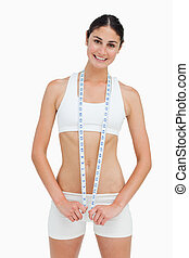 Slim woman with a measure tape