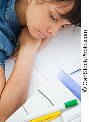 High-angle view of a female student sleeping on her homework