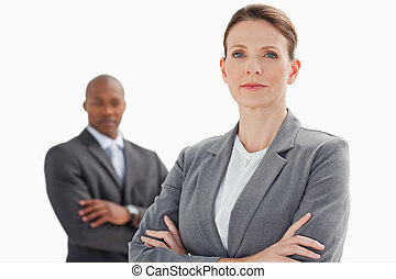 A businesswoman with folded arms stand in front of...