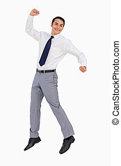 Businessman raising his arms and jumping against white...