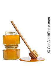 wooden dipper with honey and bottle isolated