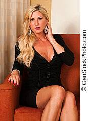 Blonde - Beautiful mature blonde in a little black dress