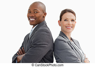 Smiling business man and woman - Business man and woman are...