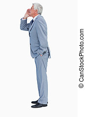 Profile of a businessman calling against white background