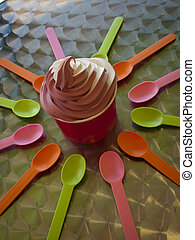 Frozen Soft Serve Yogurt - Spoons and cup with frozen soft...
