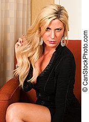 Blonde - Beautiful mature blonde in a little black dress