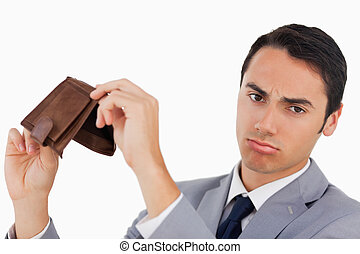 Portrait of a man in a suit with his wallet empty