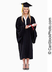 Smiling blonde student in graduate robe holding her diploma